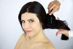 Beautiful woman getting hair brushed Stock Photo