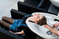 Beautiful woman getting a hair wash in beauty salon Stock Image