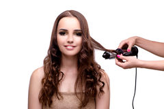 Beautiful woman getting her hair done with hair dryer isolated o Stock Photography