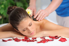 Beautiful Woman Getting Hot Rock Spa Therapy royalty free stock photography