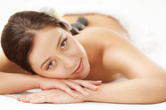 Beautiful Woman Getting Hot Stone Massage in Spa Salon. Beauty t. Reatment Royalty Free Stock Images