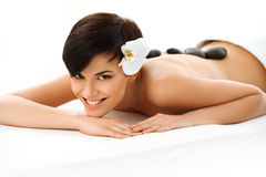 Beautiful Woman Getting Hot Stone Massage in Spa Salon. Beauty t. Reatment Royalty Free Stock Image