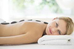 Beautiful Woman Getting Lastone Therapy At Spa Stock Photos