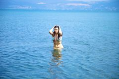 Beautiful woman getting out of the water in lake Stock Photography