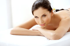 Beautiful Woman Getting Spa Hot Stones Massage. Spa Tretment. Beautiful Woman Getting Spa Hot Stones Massage in Spa Salon royalty free stock photography