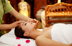 Beautiful woman getting spa treatment. Young attractive girl having head massage at spa resort Royalty Free Stock Photos