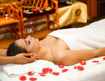 Beautiful woman getting spa treatment. Young attractive girl having head massage at spa resort Royalty Free Stock Photo