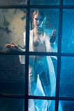 Beautiful woman ghost behind the glass Royalty Free Stock Photos