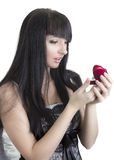 Beautiful woman with gift. In heart-shaped box Stock Photography