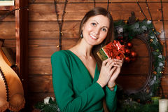 Beautiful woman with gift. Box at home Royalty Free Stock Photography