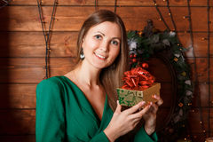 Beautiful woman with gift. Box at home Stock Photo