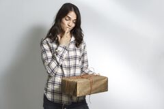 Beautiful woman with a gift box