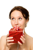 Beautiful woman with a gift in hands looking up Royalty Free Stock Images