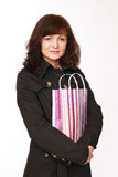 The beautiful woman with a gift package Royalty Free Stock Photos