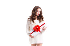 Beautiful woman with a gift - a white box with a red ribbon. Isolated Stock Photos