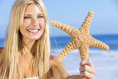 Beautiful Woman Girl In Bikini With Starfish At Beach Royalty Free Stock Images