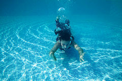 Beautiful woman girl dress underwater diving swim blue sunny day pool Royalty Free Stock Images