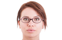 Beautiful woman or girl face wearing eyeglasses Stock Images