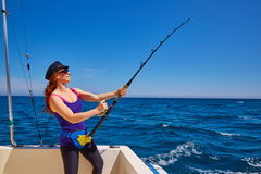 Beautiful woman girl fishing rod trolling in boat. Beautiful woman girl fishing rod trolling in saltwater in a boat trolling Royalty Free Stock Photos