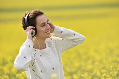 Beautiful woman girl listening to music in headphone Royalty Free Stock Photo