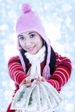Beautiful woman giving dollar bills Stock Photography