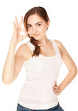 Beautiful woman giving okay sign isolated Royalty Free Stock Photos