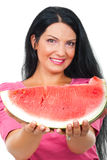 Beautiful woman giving watermelon Stock Photo
