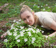 Beautiful woman on a glade of blossoming snowdrops in the early spring Royalty Free Stock Image