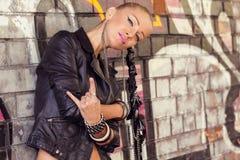 Beautiful woman in glam rock style Stock Photo