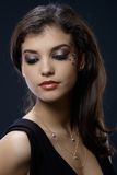 Beautiful woman in glamorous makeup. Closeup portrait of beautiful woman in glamorous makeup with strasses Royalty Free Stock Images