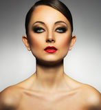 Beautiful woman with a glamorous retro makeup Stock Photos