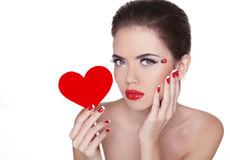 Beautiful woman with glamour bright makeup holding red heart iso Royalty Free Stock Images
