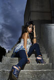 Beautiful woman in a glamour shot on stairs Royalty Free Stock Photo