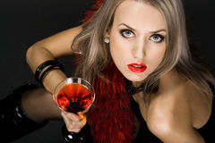 Beautiful woman with glass Stock Images