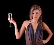 Beautiful woman with a glass of champagne Stock Photos