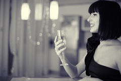 Beautiful woman with glass of champagne. Beautiful smiling woman with glass of champagne at restaurant Royalty Free Stock Photography