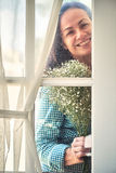 Beautiful woman at glass door Stock Photos