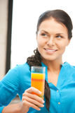 Beautiful woman with glass of juice Stock Photos
