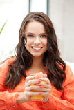 Beautiful woman with glass of juice Royalty Free Stock Photos