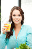 Beautiful woman with glass of juice Royalty Free Stock Image