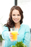 Beautiful woman with glass of juice Stock Images