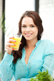 Beautiful woman with glass of juice Royalty Free Stock Images