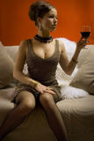 Beautiful woman with glass red wine Stock Photography