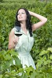 Beautiful woman with glass red wine in vineyard Stock Photos