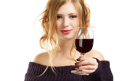 Beautiful woman with glass of red wine. Young beautiful woman with expressive hairstyle and glass of red wine isolated on white background Royalty Free Stock Images