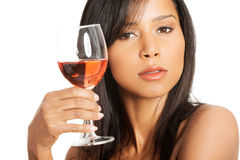 Beautiful woman with glass of rose wine Stock Photo