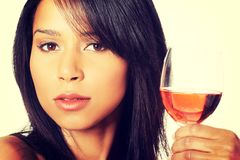 Beautiful woman with glass of rose wine Royalty Free Stock Photography