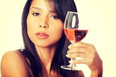 Beautiful woman with glass of rose wine Stock Images