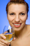 Beautiful woman with glass of white wine Royalty Free Stock Photography