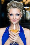 Beautiful woman with a glass of wine Royalty Free Stock Images